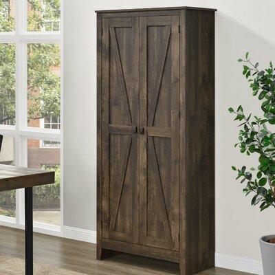 Wittenburg Storage Cabinet Finish: Brown