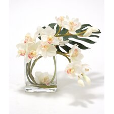 Waterlook Orchid Silk with Split Philodendron Leaf in Curved Rectangular Clear Glass Vase