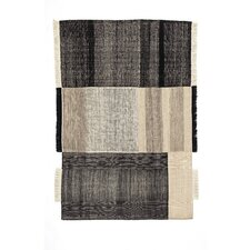 Tres Hand-Loomed Black Area Rug