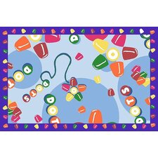 Tootsie Roll Dots Area Rug