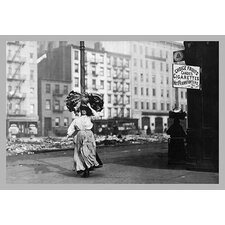 Immigrant Woman Walks Down Street Carrying a Pile of Clothing on Her Head Photographic Print