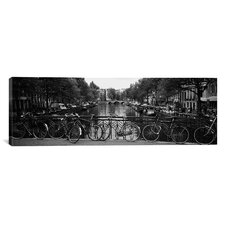 Panoramic Bicycle Leaning Against a Railing Photographic Print on Canvas
