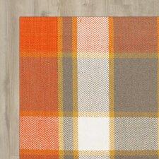 Anzell Orange Area Rug