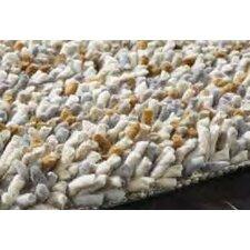 Handgewebter Teppich Rock in naturbelassenen Farbtönen