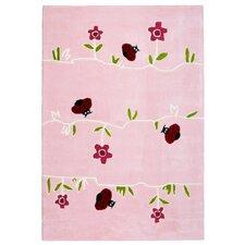 Kinderteppich Blumenwiese in Rosa