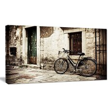 'Bicycle with Shopping Bag' Photographic Print on Wrapped Canvas