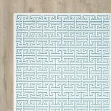 Goetz Ivory/Turquoise Area Rug