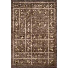Tibetan Plum Pictogram Brown Area Rug