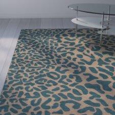 Macias Teal Animal Print Area Rug