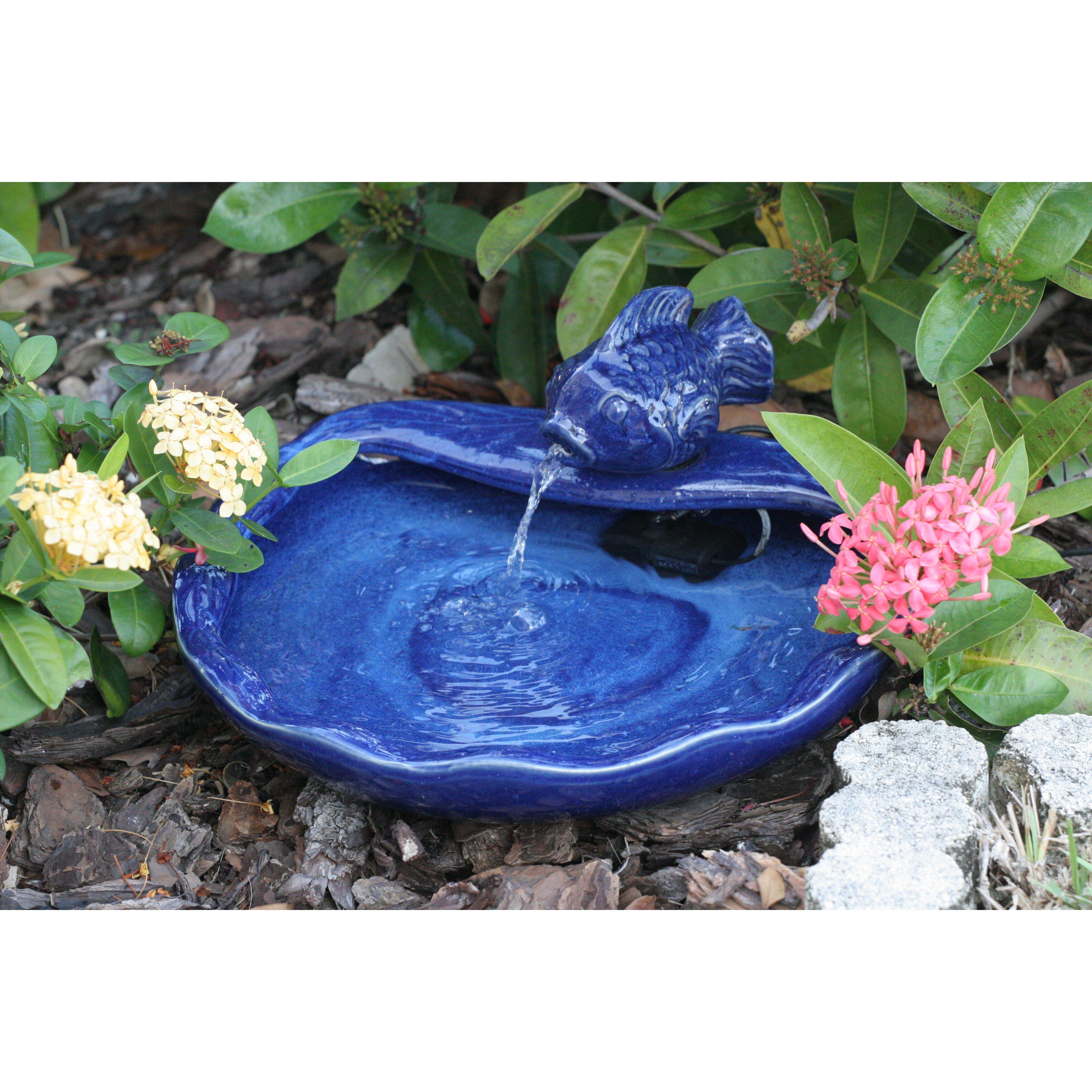 Smart solar solar water features ceramic koi fountain for Koi pond fountains sale